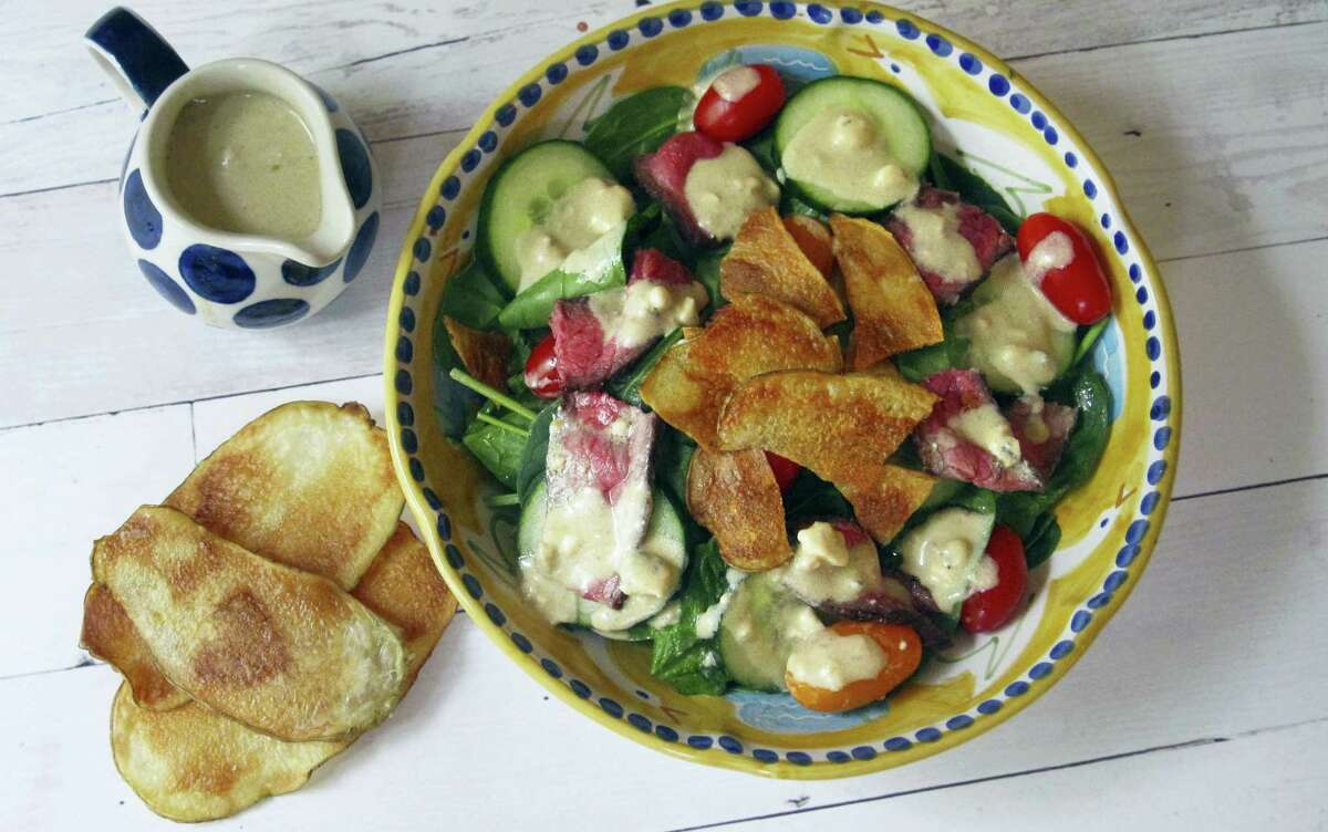Warm steak and potato chip salad with blue cheese dressing.