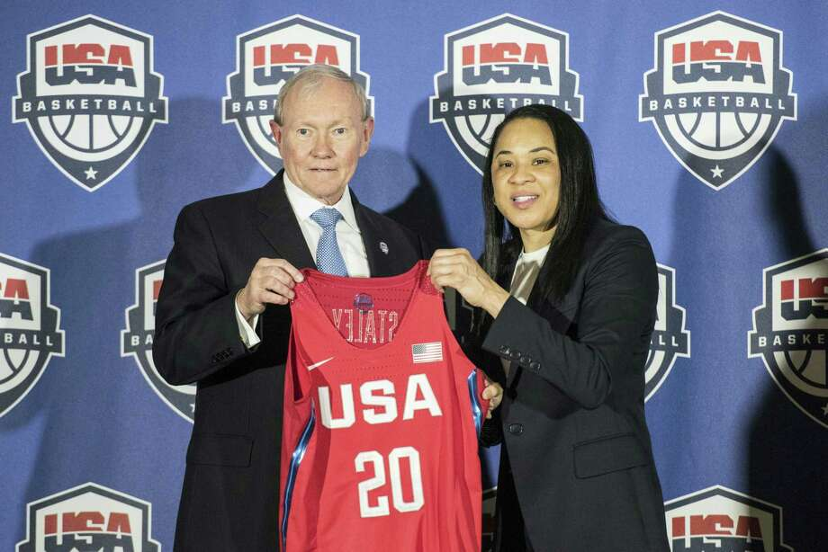 National Basketball Chairman Gen. Martin Dempsey, left, presents a jersey to South Carolina women's head basketball coach Dawn Staley, right, during a press conference on Friday. Photo: Sean Rayford — The Associated Press   / The Associated Press