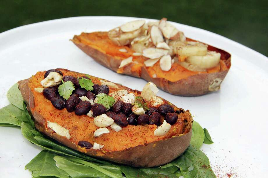 Two halves of a sweet potato prepared with savory and sweet toppings. Photo: Melissa D'Arabian Via AP   / Melissa d'Arabian