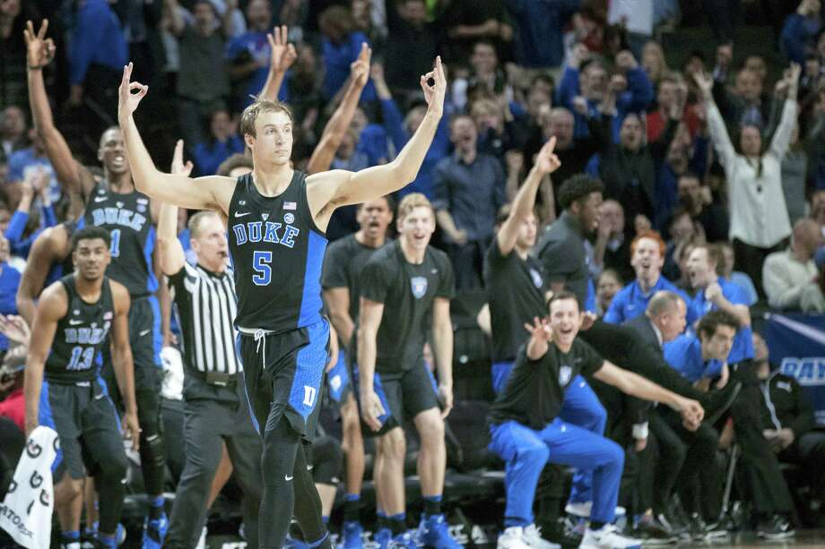 Duke guard Luke Kennard (5) reacts after scoring a 3-pointer during the second half of an NCAA college basketball game against Louisville in the Atlantic Coast Conference tournament, Thursday in New York. Duke won 81-77. Photo: Mary Altaffer — The Associated Press   / Copyright 2017 The Associated Press. All rights reserved.