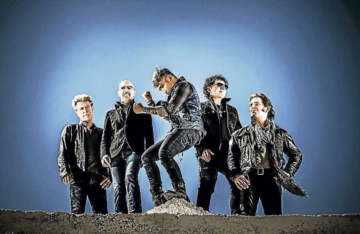 Arnel Pineda, center, is lead singer for Journey these days.