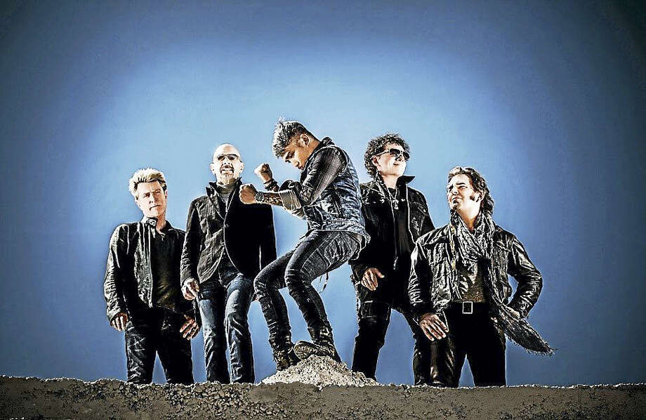 Arnel Pineda, center, is lead singer for Journey these days. Photo: Contributed Photo