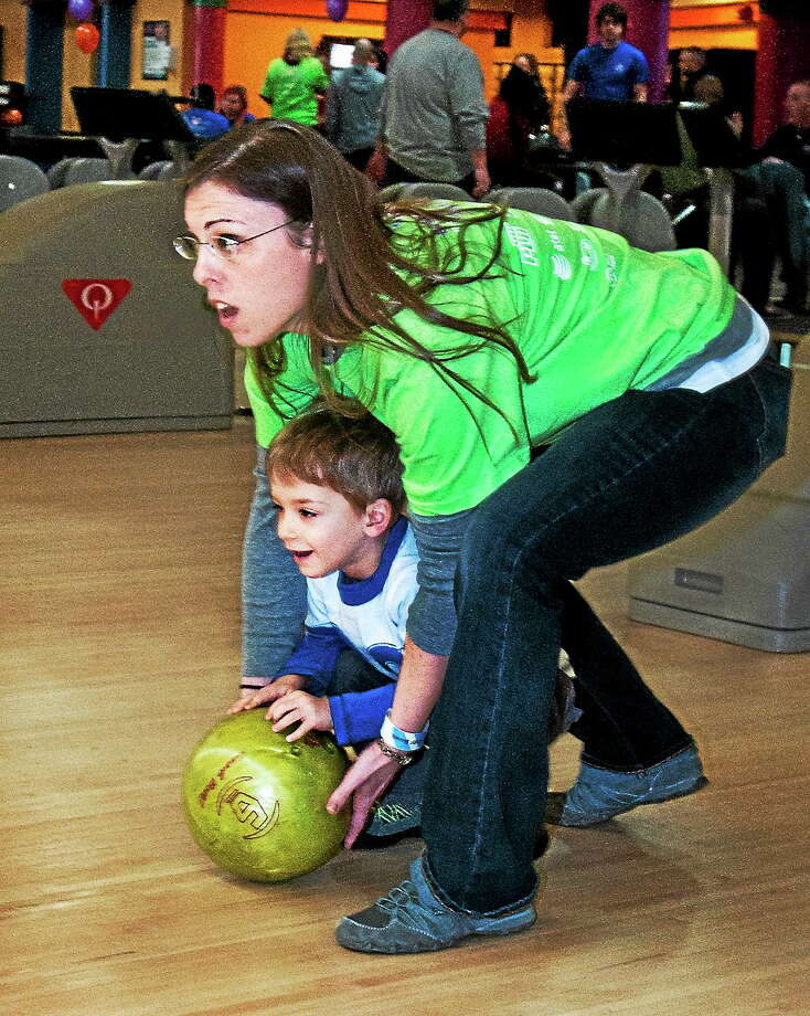 Logan Soulsby, 3, of Hamden, gets some bowling help from mom, Debbie Soulsby, during the 26th annual BHCare Bowl-2-Benefit The Umbrella Center for Domestic Violence Services. Debbie Soulsby is development coordinator for BHCare. The event was held at AMF Lanes in Milford. Photo: Melanie Stengel — New Haven Register FILE PHOTO   / Melanie Stengel