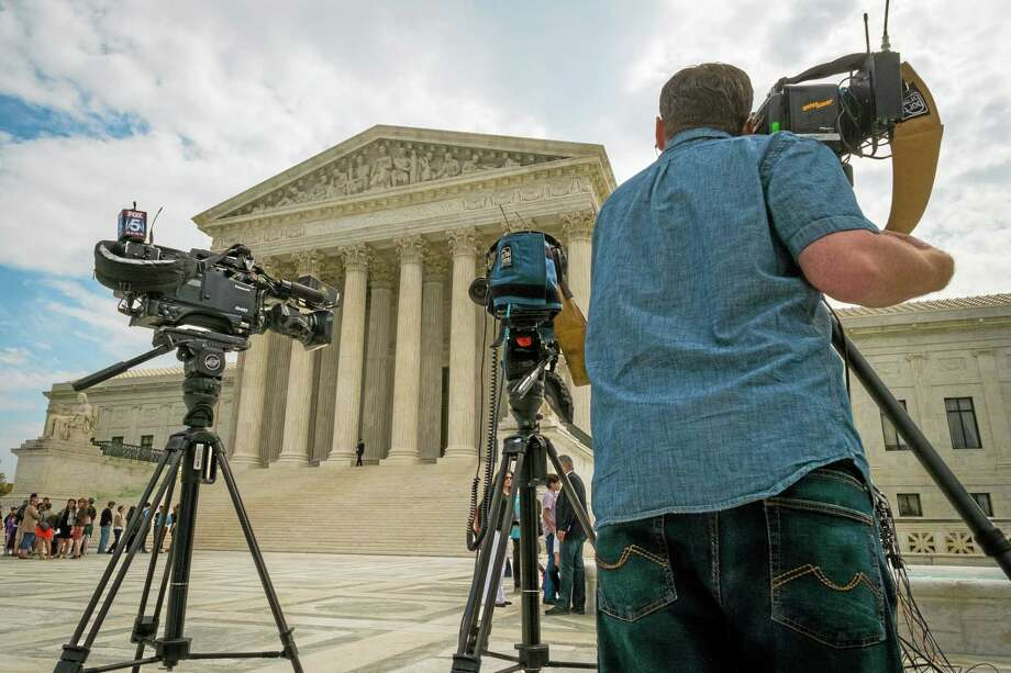 Videojournalists set up outside of the U.S. Supreme Court in Washington Tuesday. Photo: J. David Ake — THE ASSOCIATED PRESS   / AP