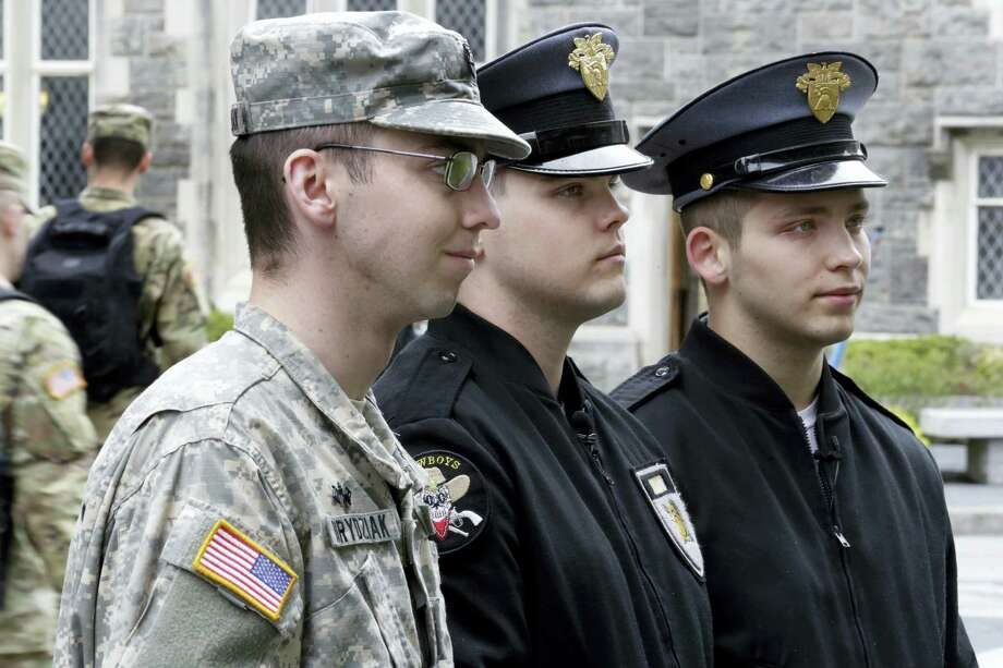In this Friday April 21, 2017, photo, Cadet Noah Ogrydziak, left, and his twin brother Cadets Cole Ogrydziak, center, and Sumner Ogrydziak, are interviewed at the U.S. Military Academy, at West Point, N.Y. The three Texas brothers will graduate with the U.S. Military Academy'Äôs Class of 2017 on May 27, marking the first time in more than three decades that three siblings have finished at the storied institution at the same time. Photo: AP Photo/Richard Drew    / AP