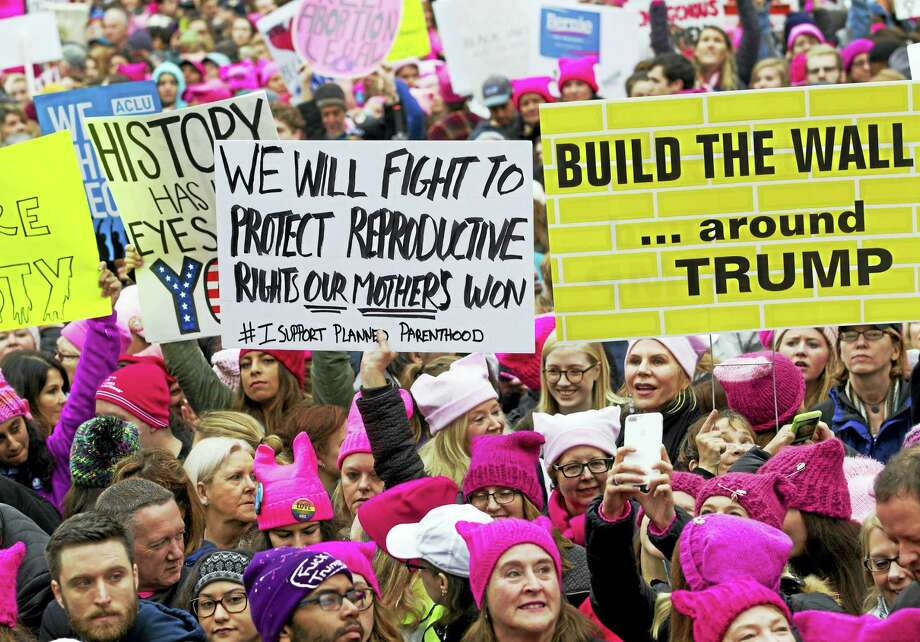 Women with bright pink hats and signs begin to gather early and are set to make their voices heard on the first full day of Donald Trump's presidency, Saturday, Jan. 21, 2017, in Washington.  Organizers of the Women's March on Washington expect more than 200,000 people to attend the gathering. Photo: Jose Luis Magana — AP Photo   / FR159526 AP