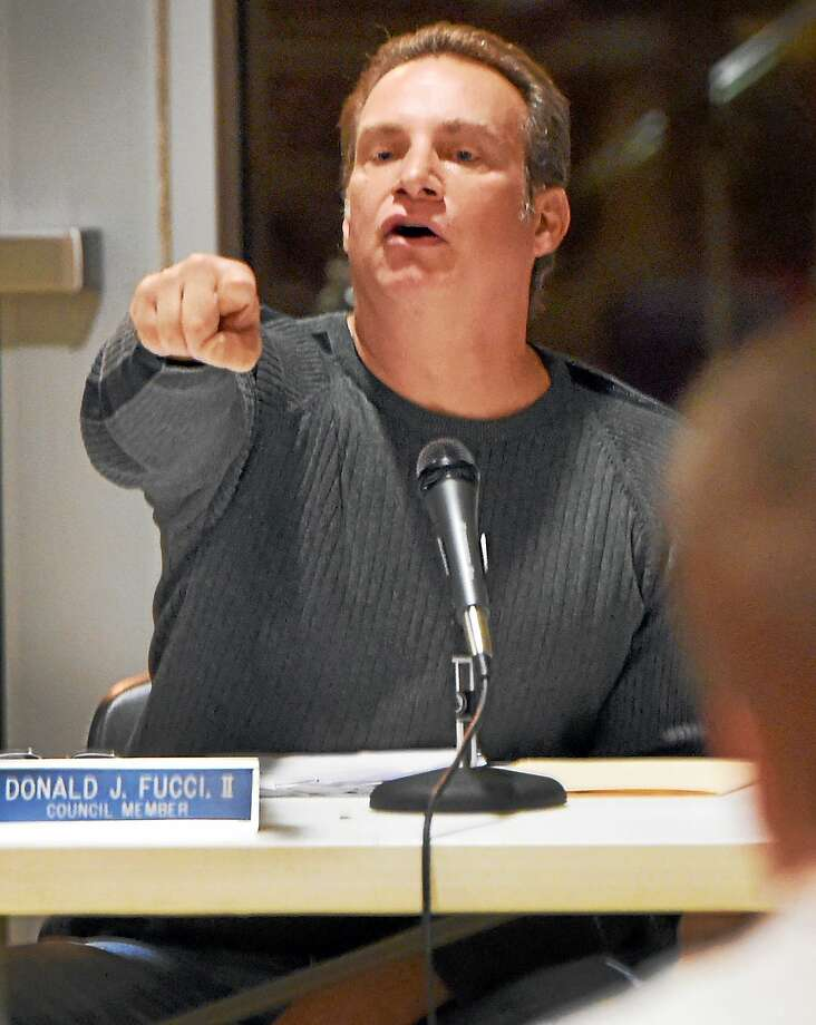 North Branford Town Council member Donald J. Fucci, II responds to criticism by a North Branford resident of conflict of interest during a hearing about the development of proposed J.J. Sullivan bulk propane storage tanks in North Branford during a Town Council meeting at the North Branford Intermediate School in 2014. Photo: Peter Hvizdak - New Haven Register File Photo   / ©2014 Peter Hvizdak
