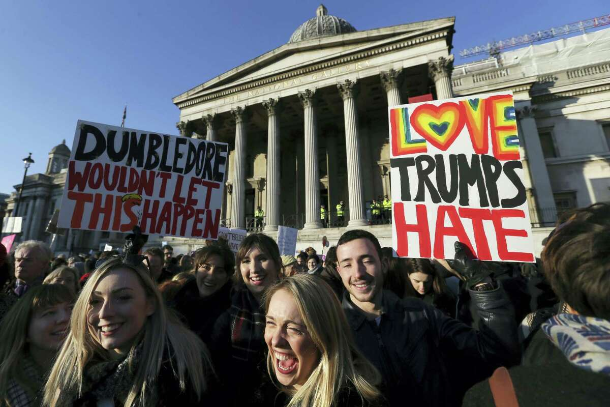 Demonstrators take part in the Women's March in Trafalgar Square, central London, following the Inauguration of U.S. President Donald Trump in London, Saturday Jan. 21, 2016. The march is being held in solidarity with the Women's March in Washington and other cities worldwide, advocating women's rights and opposing Donald Trump's U.S. presidency.
