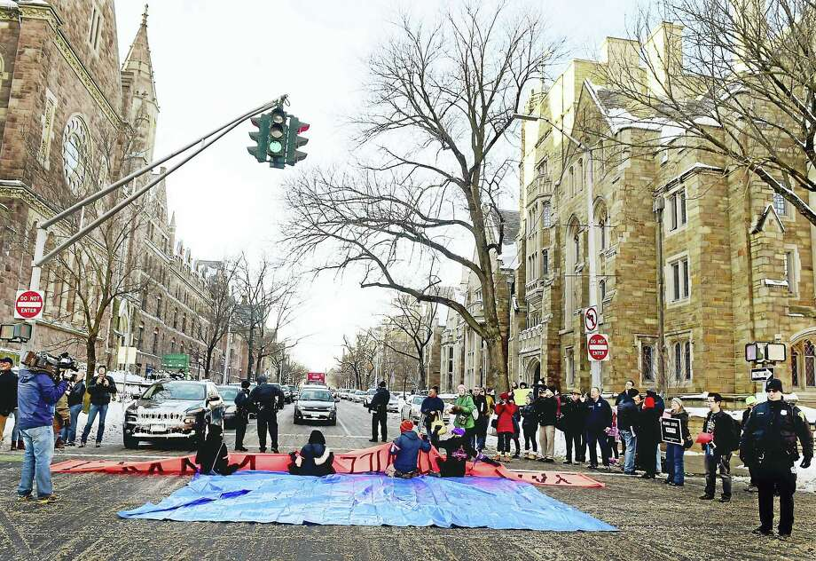 New Haven police arrested demonstrators who blocked the intersection of Elm and College streets in New Haven Friday afternoon and refused to move during a protest calling for changing the name of Yale University's Calhoun College. The arrests were planned and coordinated between the demonstrators and New Haven police. Photo: Peter Hvizdak — New Haven Register   / ?2017 Peter Hvizdak