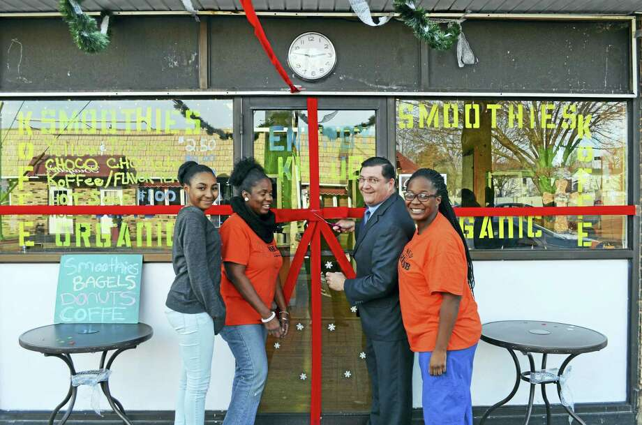 "ENERGY KHLUB: West Haven Mayor Edward M. O'Brien cuts the ribbon Jan. 5 with Energy Khlub owner Mahogany Mathis, right, and her mother, Knia Mathis, second from left, and her sister, Malaizja Mathis, to mark the organic beverage shop's ceremonial opening at 82 Campbell Ave. ""West Haven's new healthy drink shop"" blends a clever concoction of smoothies — raspberry jungle milk, sweet potato pie, vanilla lime zest — with such staples as coffee, tea, apple cider and hot chocolate. The lower Campbell Avenue business, owned and operated by the Mathis family, also whips up fresh bagels, cake, cookies, soup and doughnuts. The Energy Khlub is open weekdays from 8 a.m. to 6 p.m. and Saturdays from 8:30 a.m. to 6 p.m. Photo: CONTRIBUTED — Michael P. Walsh/City Photo"
