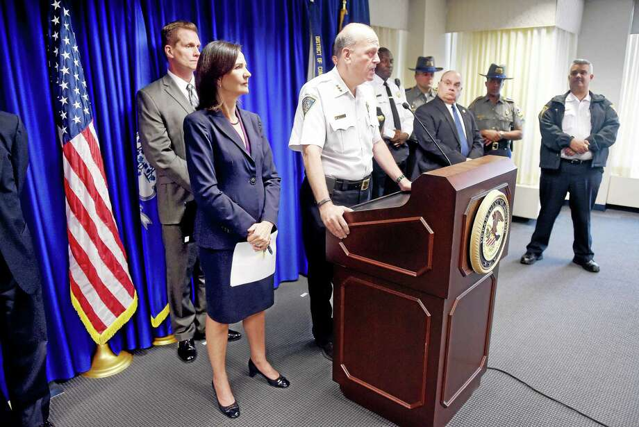 Then-New Haven Police Chief Dean Esserman, center, answers a question during a press conference announcing federal murder, racketeering, firearms, narcotics and money laundering charges against members of New Haven gang the Red Side Guerilla Brims, at the U.S. Attorney's office in New Haven in 2015. Photo: Arnold Gold — New Haven Register FILE PHOTO