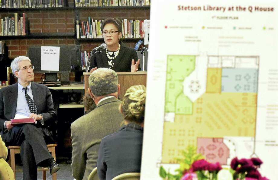 Mayor Toni Harp, right, joins Yale University President Peter Salovey, left, to announce a community fundraising effort to move the Stetson branch library into the new Q House on Dixwell Avenue in New Haven, which has yet to be built. Photo: Peter Hvizdak — New Haven Register