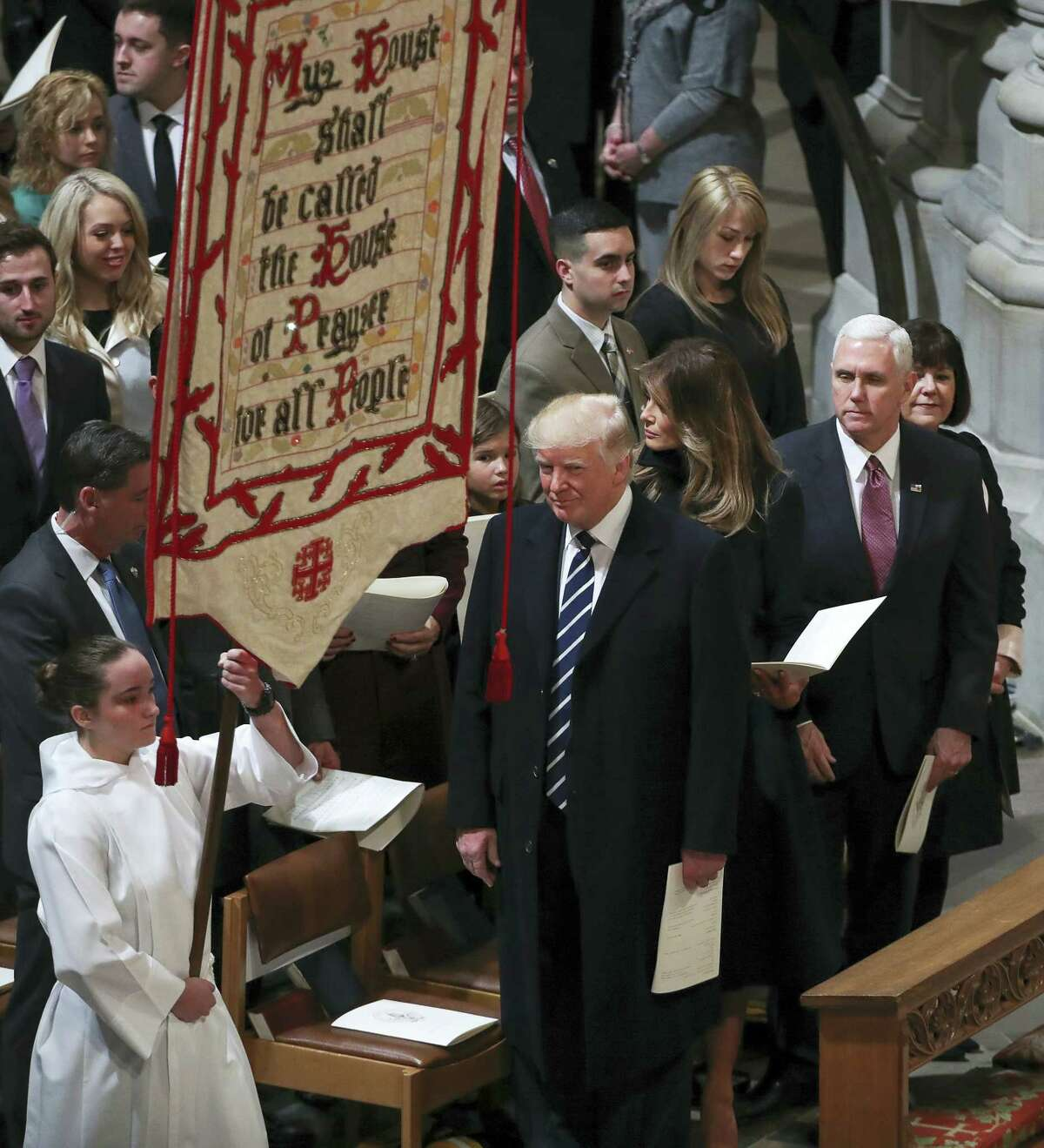 President Donald Trump, first lady Melania Trump and Vice President Mike Pence, second from right, and his wife Karen, right, attend a National Prayer Service at the National Cathedral in Washington on Saturday.
