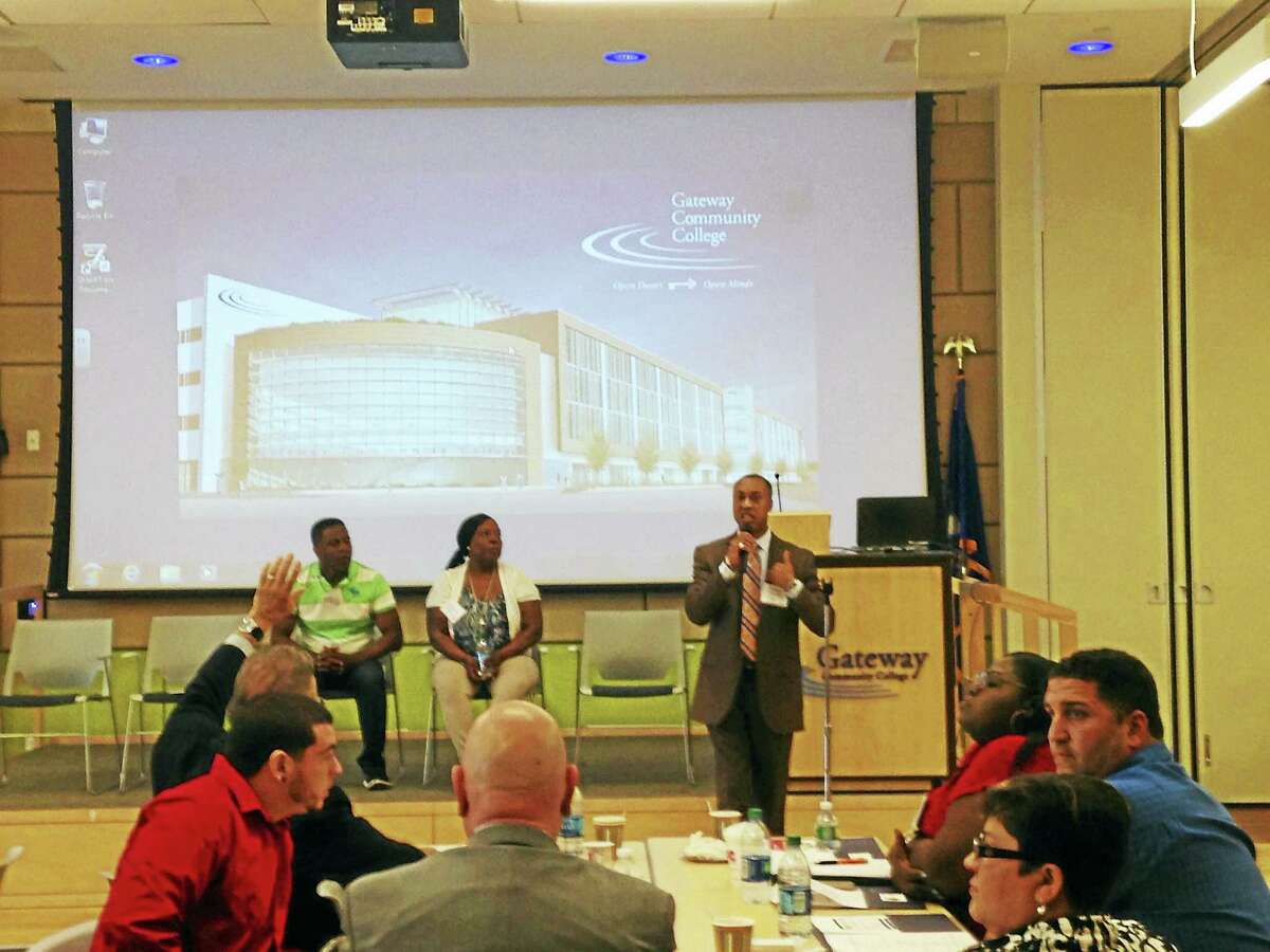 Charles Grady, spokesperson for the FBI in New Haven, facilitates a panel discussion about the barriers facing former inmates seeking employment, during an event at Gateway Community College in New Haven.