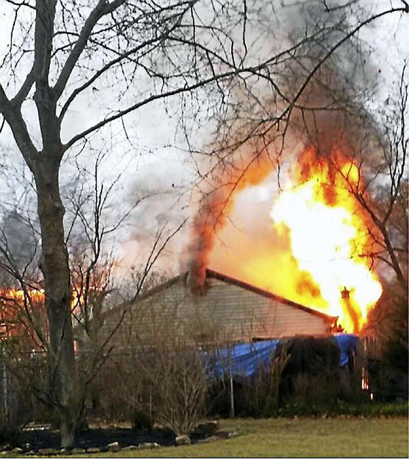 The North Haven Fire Department extinguished a house fire Saturday morning that originated in the home's attached garage. Photo: Courtesy Photo