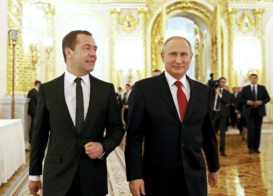 Russian Prime Minister Dmitry Medvedev, left, and President Vladimir Putin walk after the president delivered his annual state of the nation address in the Kremlin in Moscow, Russia, Thursday, Dec. 1, 2016. Photo: Dmitry Astakhov/ Sputnik, Government Press Service Pool Photo Via AP  / POOL SPUTNIK GOVERNMENT
