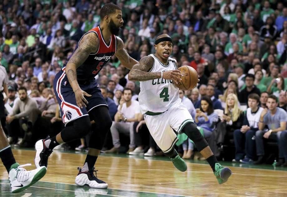 Boston Celtics guard Isaiah Thomas drives to the basket past Washington Wizards forward Markieff Morris during the second quarter of Game 5 of an NBA basketball second-round playoff series in Boston Wednesday. The Celtics won 123-101. Photo: CHARLES KRUPA — The Associated Press   / Copyright 2017 The Associated Press. All rights reserved.