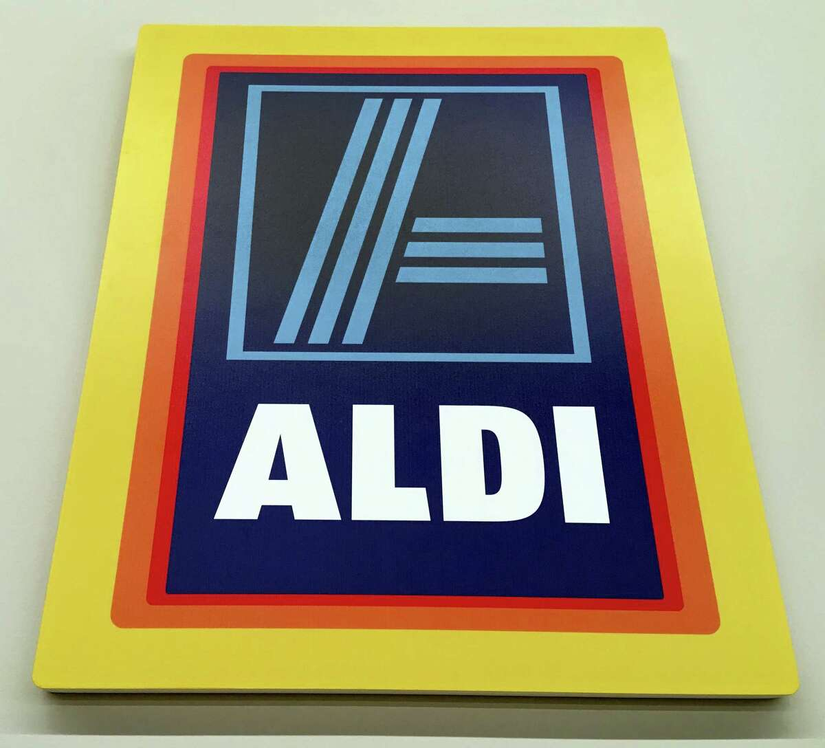 This June 5, 2017, photo, shows signage at an Aldi food market, in Salem, N.H. Discounter Aldi, one of the no-frills European chains that offer low prices but far fewer options, and mostly its own brands, is putting the pressure on traditional grocers. Aldi expects to have 2,500 U.S. stores by the end of 2022. (AP Photo/Elise Amendola)