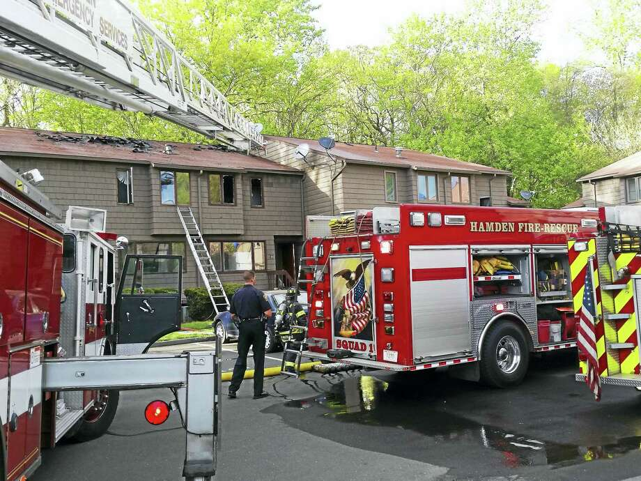Hamden firefighters responded to a multi-unit condo fire at Hillside Village housing complex on Townsend Road Wednesday. Photo: Kathleen Schassler — New Haven Register