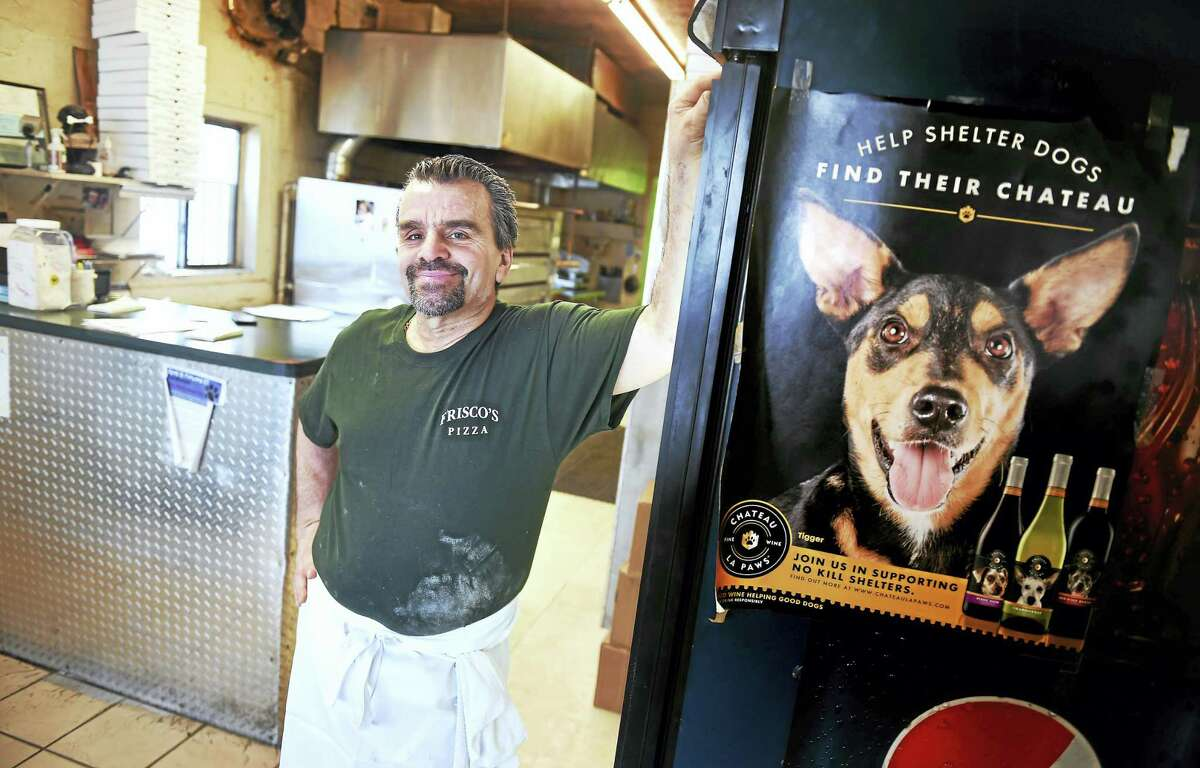 John Frisco, owner of Frisco's Pizza, is photographed Friday in his restaurant on Forbes Avenue in New Haven, where a fundraiser will be held on March 19 for Hope, an emaciated dog found in Branford.