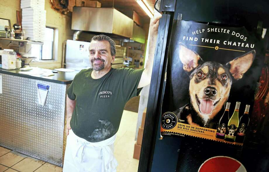 John Frisco, owner of Frisco's Pizza, is photographed Friday in his restaurant on Forbes Avenue in New Haven, where a fundraiser will be held on March 19 for Hope, an emaciated dog found in Branford. Photo: Arnold Gold — New Haven Register
