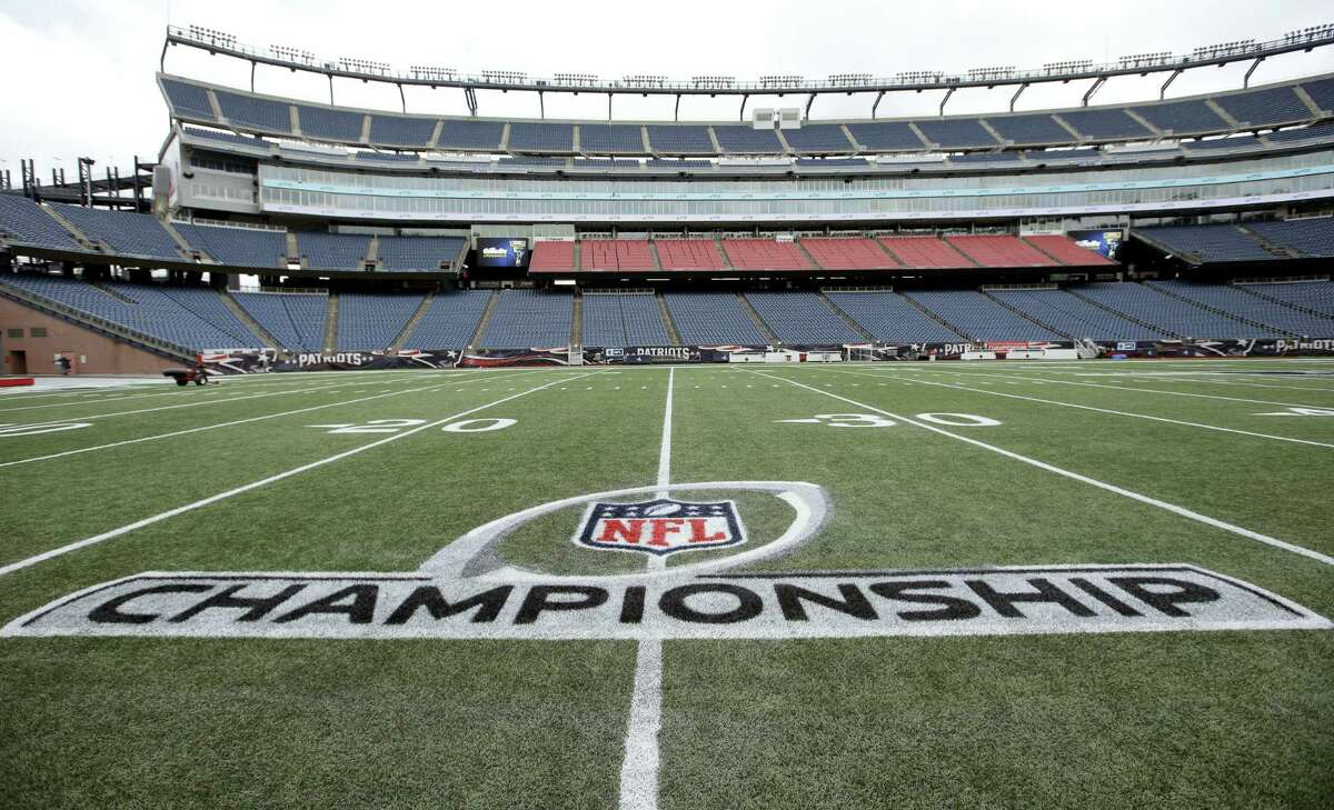 A freshly painted AFC championship logo rests on the field at Gillette Stadium.