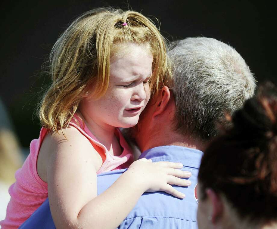 Rainier Ehrhardt — the associated press   Lilly Chapman, 8, cries after being reunited with her father, John Chapman, at Oakdale Baptist Church on Wednesday in Townville, S.C. Students were evacuated to the church following a shooting at Townville Elementary School. Photo: AP / FR155191 AP