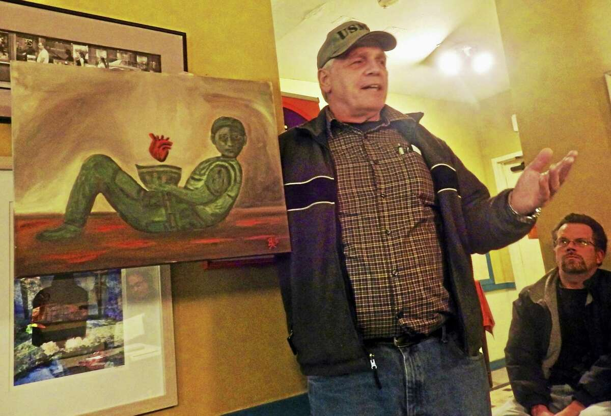"Marine Corps veteran Bob Kukiel of Seymour displays his artwork, which he said depicts ""Soldier's Heart,"" a post-Civil War term for post-traumatic stress disorder."