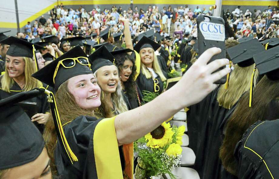 Graduate Jocelyn Peters sweeps the crowd with her smartphone to make a video at the conclusion of Jonathan Law High School's 2017 graduation Tuesday in Milford. Photo: Christian Abraham / Hearst Connecticut Media