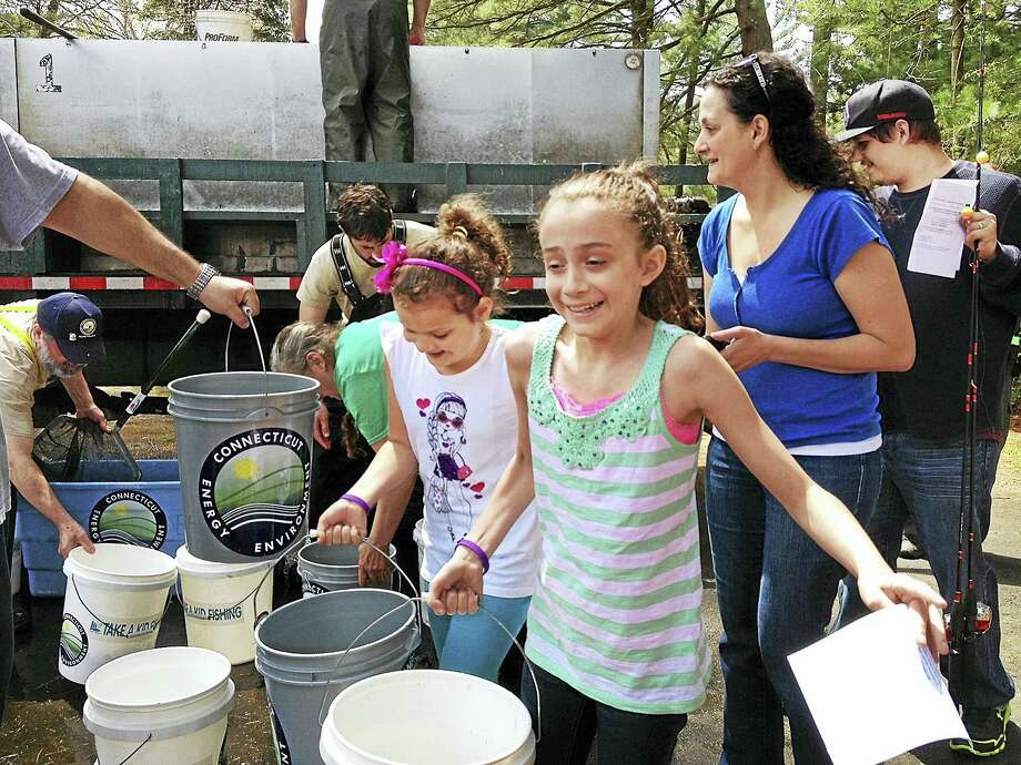 Children wait in line for their chance to take part in the most exciting event during free family fishing day in 2014 at Chatfield Hollow State Park in Killingworth. Photo: File Photo
