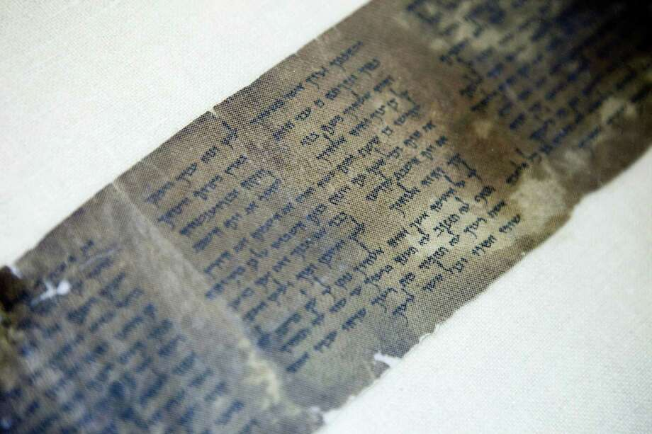 This Friday, May 10, 2013 photo shows the world's oldest complete copy of the Ten Commandments, written on one of the Dead Sea Scrolls in Jerusalem. The manuscript is on rare display at Israel's national museum in an exhibit of objects from pivotal moments in the history of civilization. Photo: AP Photo/Dan Balilty, File   / AP