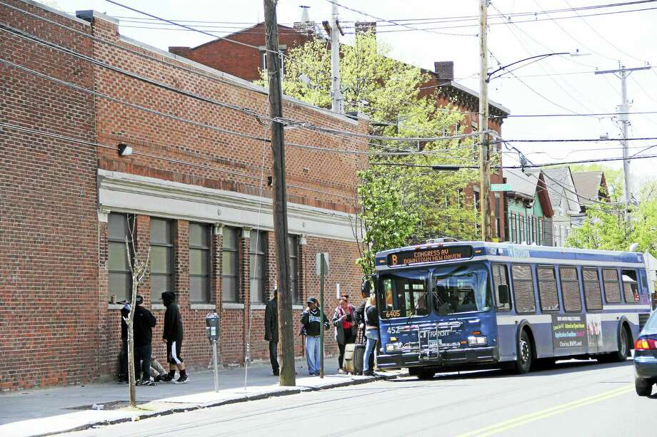 A bus stop across the street from an APT Foundation treatment center on Congress Avenue is always crowded, New Haven police say. Police have concerns about the number of people always in the area of the treatment center. Photo: Anna Bisaro — New Haven Register