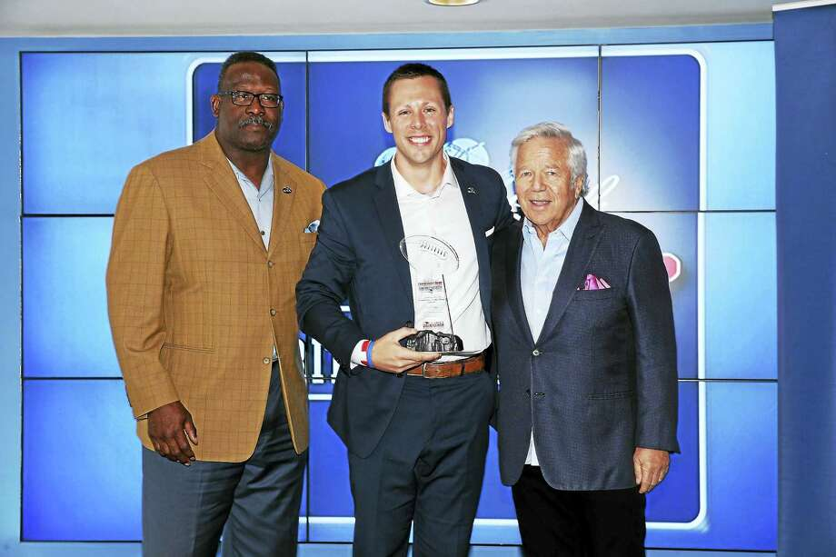 From left, Patriots Pro Hall of Famer Andre Tippett, Ryan Matthews and Patriots CEO and Chairman Robert Kraft. Photo: Contributed Photo/Eric J. Adler — New England Patriots   / NE Patriots