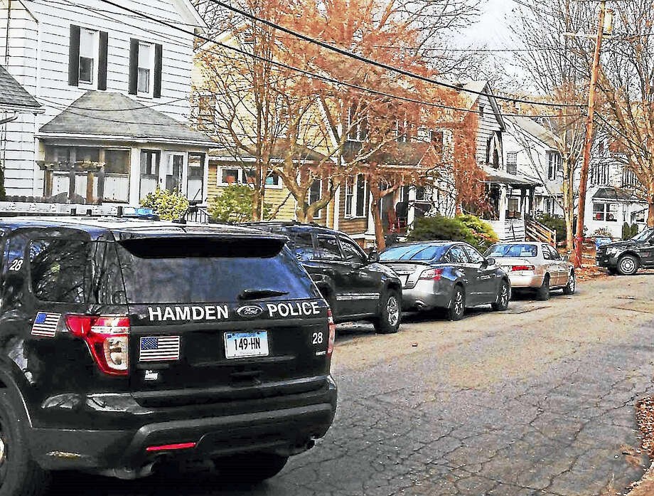 Hamden police investigate after a fire at home on Lilac Avenue in 2015. Jennifer Antonier, 45, was found dead after the fire. Photo: New Haven Register File Photo
