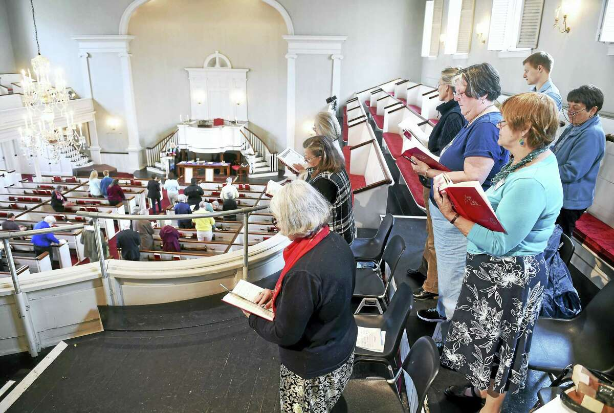 The choir takes part in services from the balcony of the United Church on the Green in New Haven.