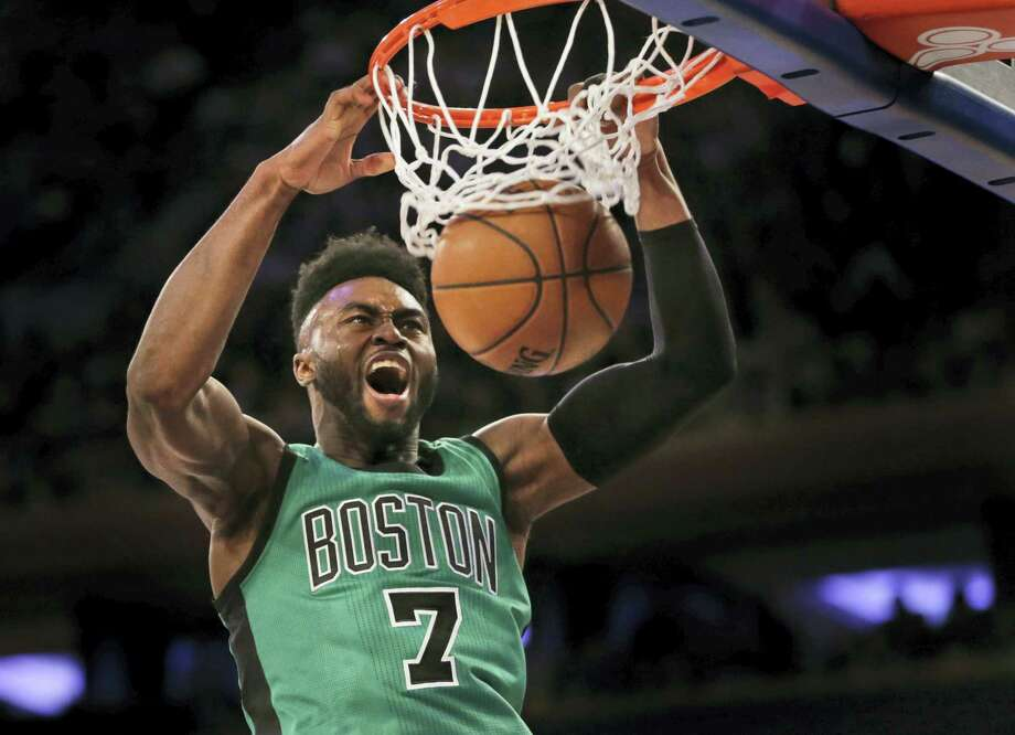 The Celtics' Jaylen Brown dunks during the second half against the Knicks on Sunday in New York. Photo: Seth Wenig — The Associated Press   / Copyright 2017 The Associated Press. All rights reserved.