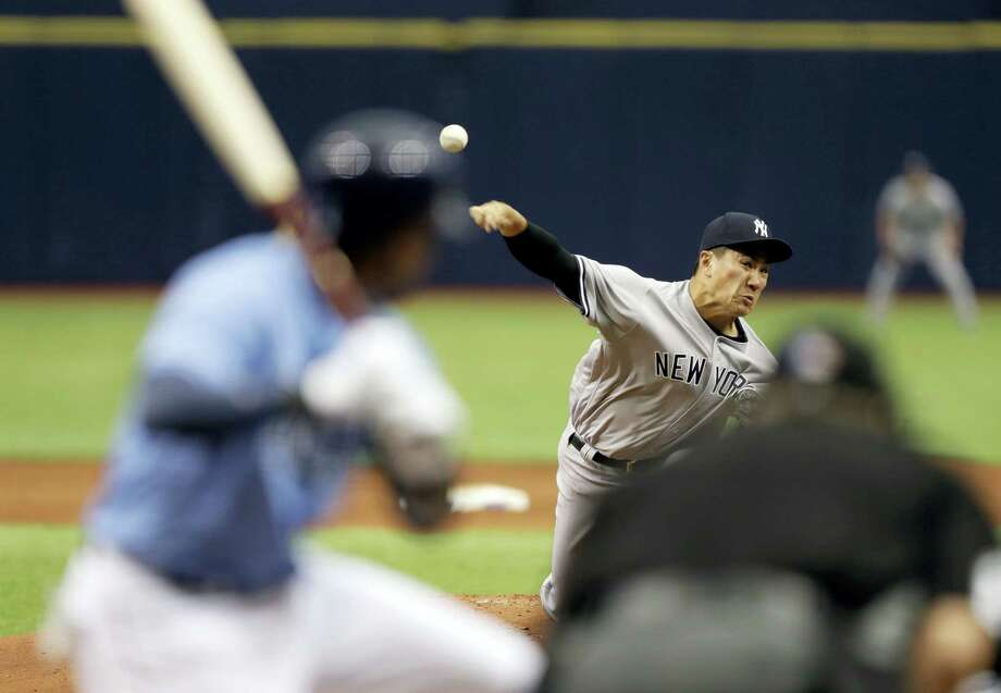 Yankees starting pitcher Masahiro Tanaka delivers in the first inning Sunday in St. Petersburg, Fla. Photo: Chris O'Meara — The Associated Press   / Copyright 2017 The Associated Press. All rights reserved.