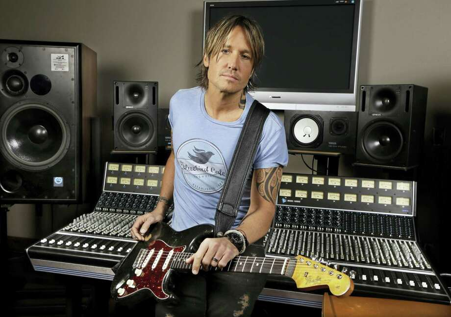In this April 14, 2016 photo, Keith Urban poses in Nashville, Tenn. CMT announced the nominees on Tuesday, May 9, 2017 for their awards show to be held on June 7 in Nashville, Tenn. Photo: AP Photo — Mark Humphrey, File   / Copyright 2017 The Associated Press. All rights reserved.