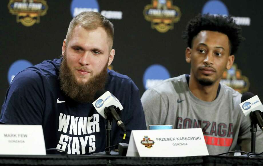 Gonzaga's Przemek Karnowski, left, and Johnathan Williams listen to a question from a reporter during a news conference for the Final Four NCAA college basketball tournament, Sunday in Glendale, Ariz. Photo: Mark Humphrey — The Associated Press   / Copyright 2017 The Associated Press. All rights reserved.