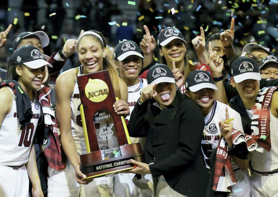 South Carolina forward A'ja Wilson holds the trophy and coach Dawn Staley points as the team celebrates their win over Mississippi State in the national championship game Sunday in Dallas. Photo: Tony Gutierrez — The Associated Press   / Copyright 2017 The Associated Press. All rights reserved.