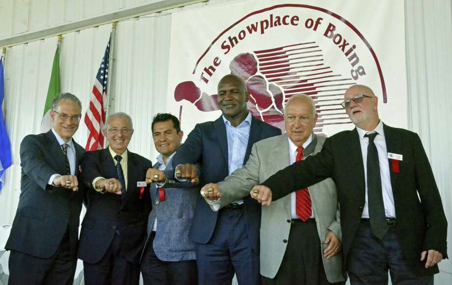International Boxing Hall of Fame Class of 2017 inductees, from left, Steve Farhood, Barry Tompkins, Marco Antonio Barrera, Evander Holyfield, Jerry Roth and Johnny Lewis display their rings following the induction ceremony in Canastota, N.Y., Sunday. Photo: Kyle Mennig — Oneida Daily Dispatch Via AP   / Oneida Daily Dispatch