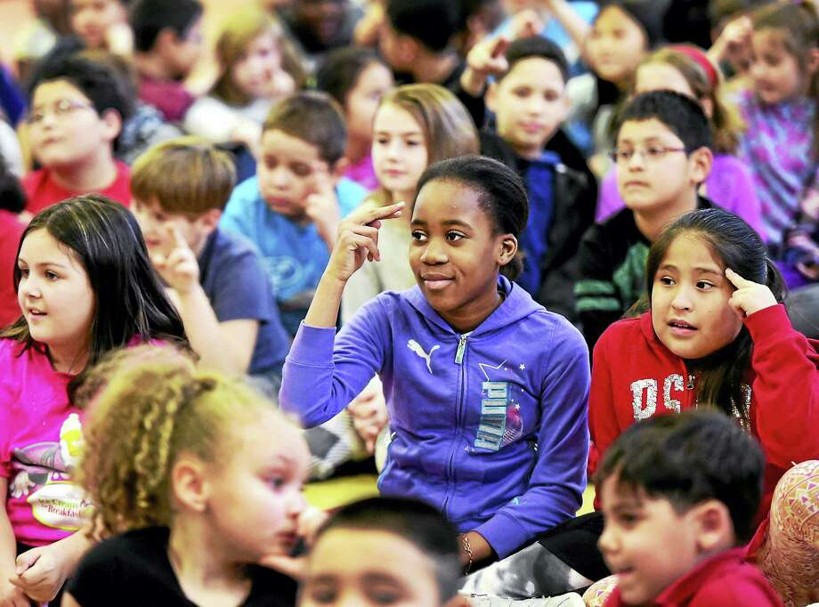"Irving School students say ""hello"" in sign language as they participate in a ""Start With Hello"" program that teaches inclusiveness Wednesday. Photo: Peter Hvizdak — New Haven Register   / ©2017 Peter Hvizdak"