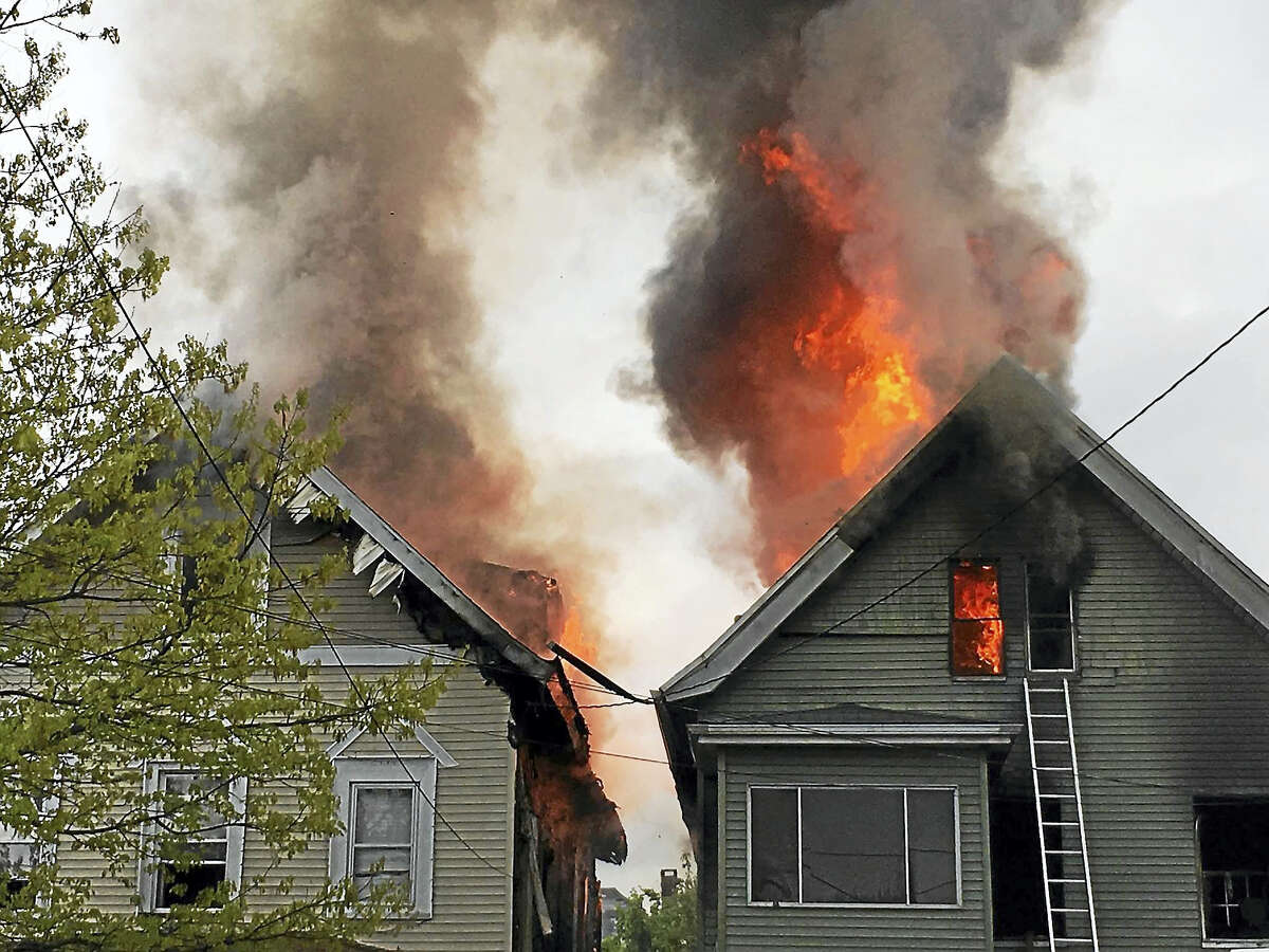 11 adults and seven children made it safely out of a Blatchley Avenue home on Sunday after a fire.