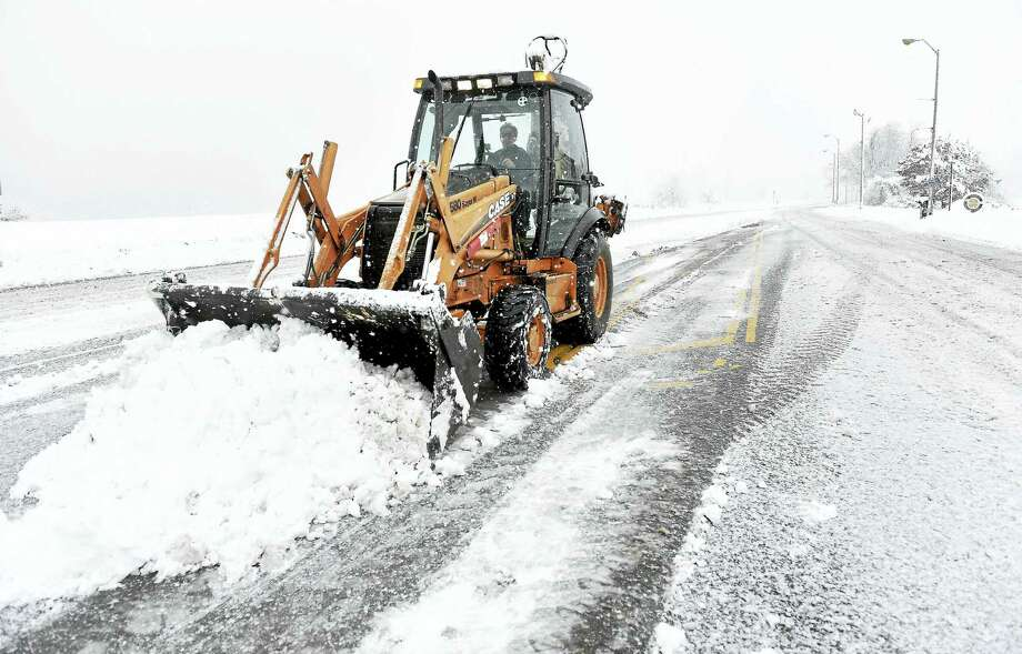 In this file photo from Feb. 2016, Robert Maselli of the West Haven Public Works Department clears snow from Captain Thomas Blvd. in West Haven. Photo: Arnold Gold — New Haven Register