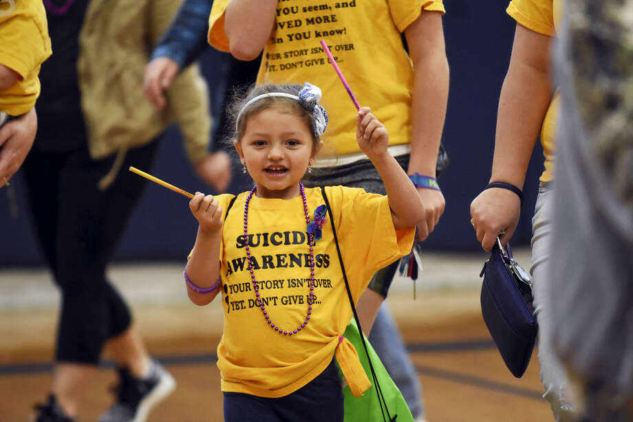 Jaylessa Mehallic, Tamaqua, Pa., walks laps around the gymnasium floor during the Stomp Out Suicide event at Schuylkill Haven Area High School in Schuylkill Haven, Pa. on May 6, 2017. Photo: Jacqueline Dormer — The Republican-Herald Via AP   / Republican-Herald