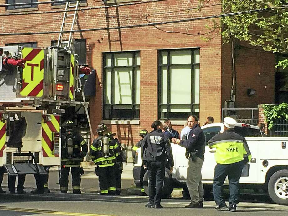Firefighters responded to a fire Monday morning at the intersection of Congress and Howard avenues. Photo: Jessica Lerner — New Haven Register