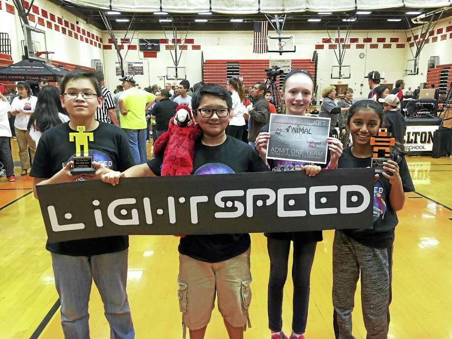 From left are  Marco, Kyle, Aislinn and Diya of team Lightspeed. Photo: Pam McLoughlin — New Haven Register