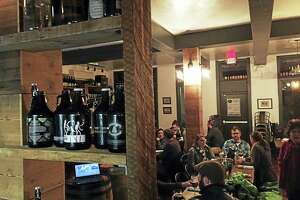 Growlers and a seminar by Sierra Nevada officials filled The Beer Collective on a recent Tuesday night.