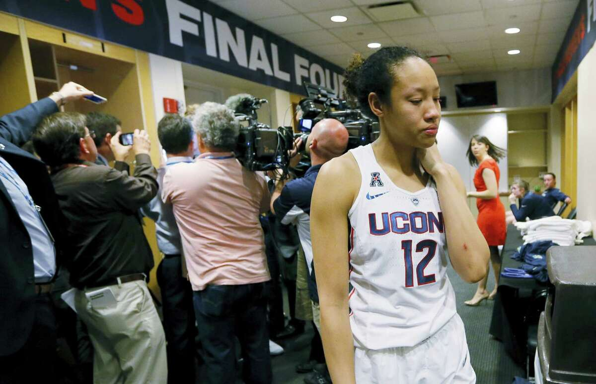 UConn's Saniya Chong (12) walks through the locker room after the Huskies' loss to Mississippi State on Friday.