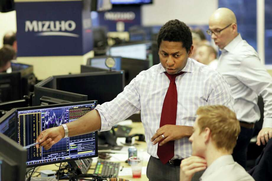 Traders work on the Mizuho Americas trading floor in New York. Photo: Mark Lennihan — AP Photo / Copyright 2017 The Associated Press. All rights reserved.